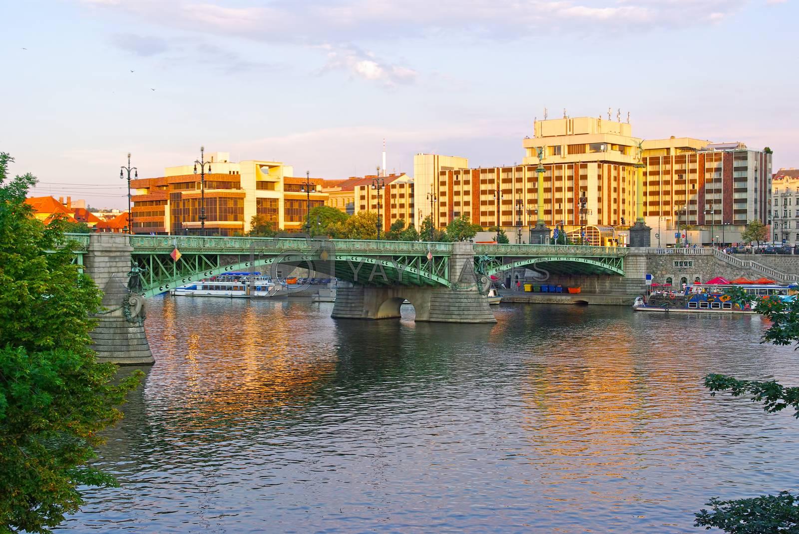 Cech bridge over Vltava river and Prague city before sunset