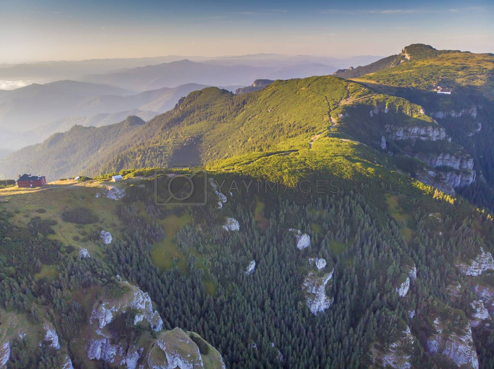 Royalty free image of Rocky Romanian Carpathians summer scene by savcoco