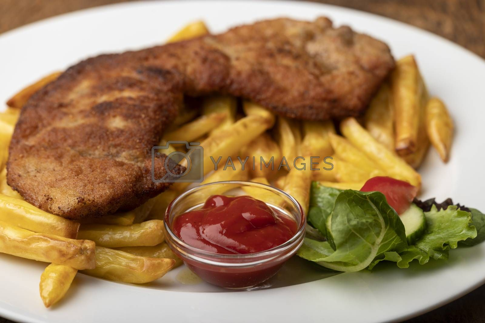 wiener schnitzel with french fries by bernjuer