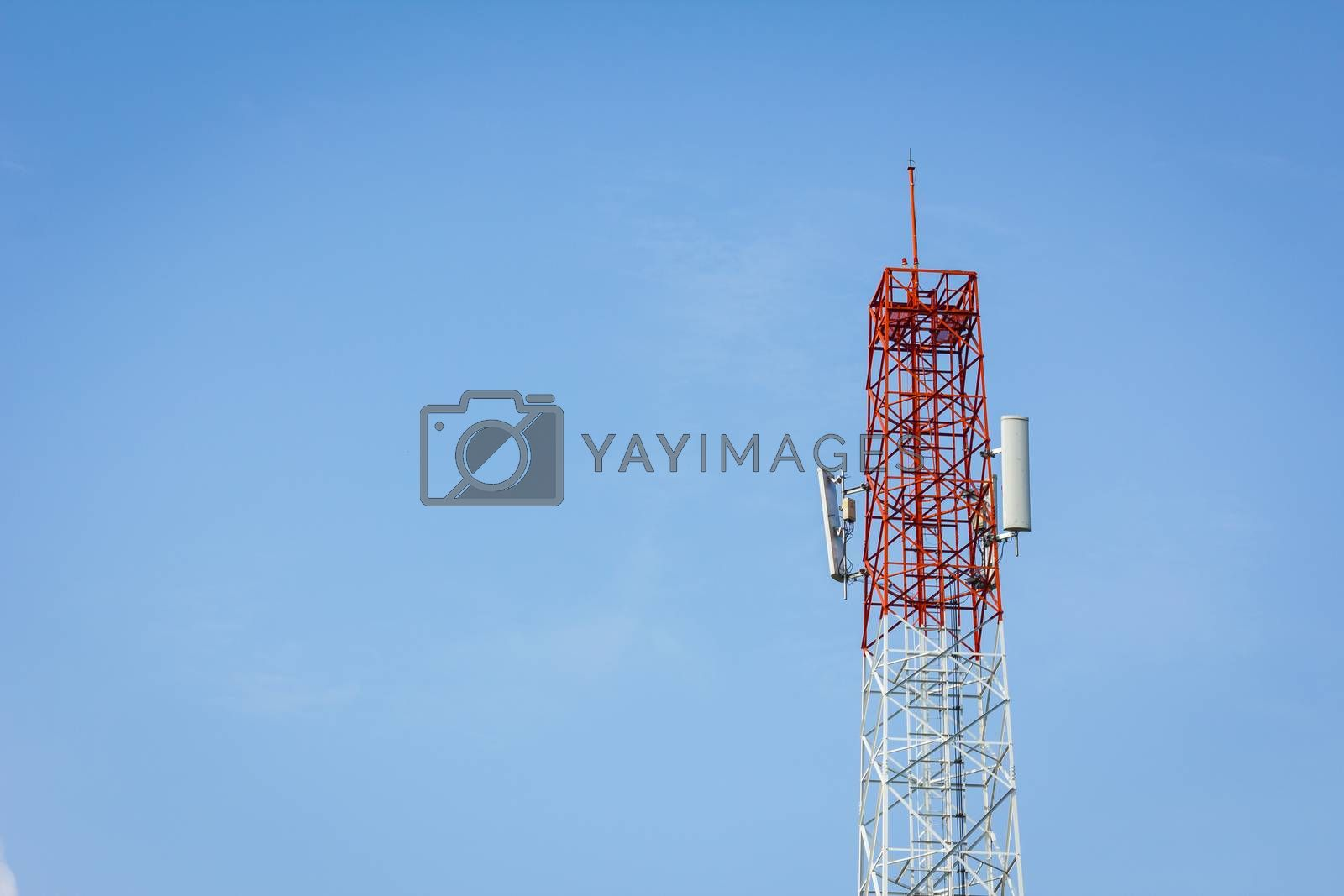 telecommunication tower and cloudy blue sky with copyspace on the left