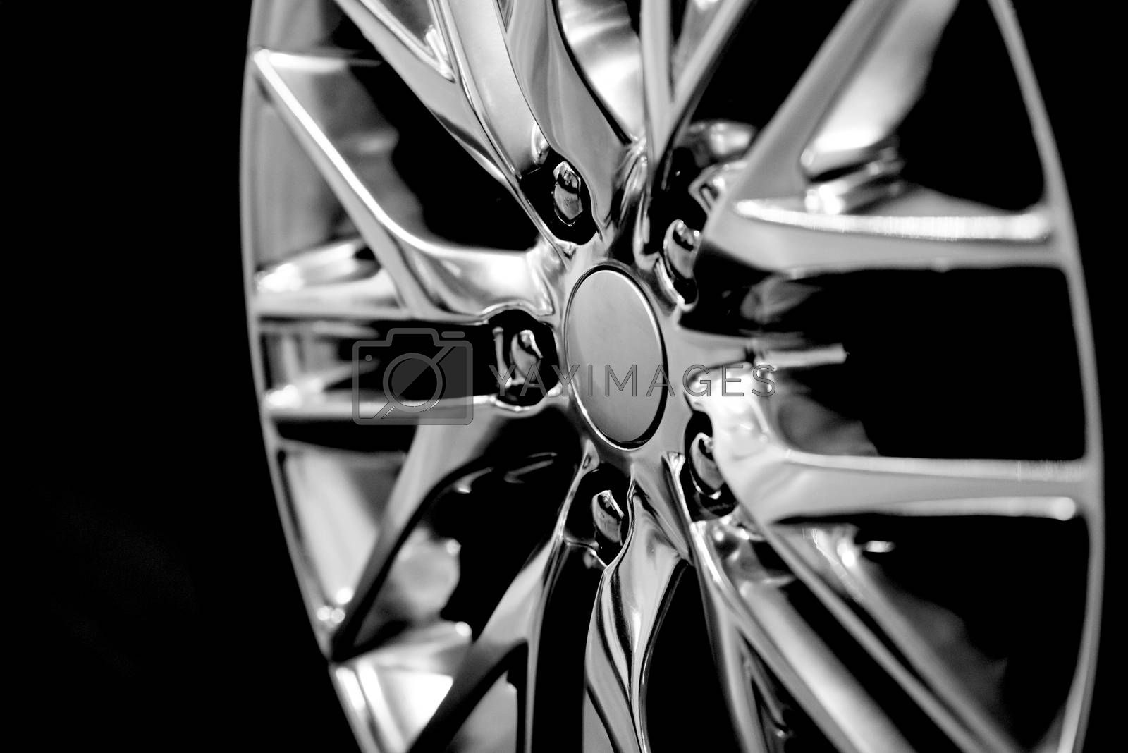 Luxury chrome alloy wheel in close-up as an automotive background (B&W HDR filter).