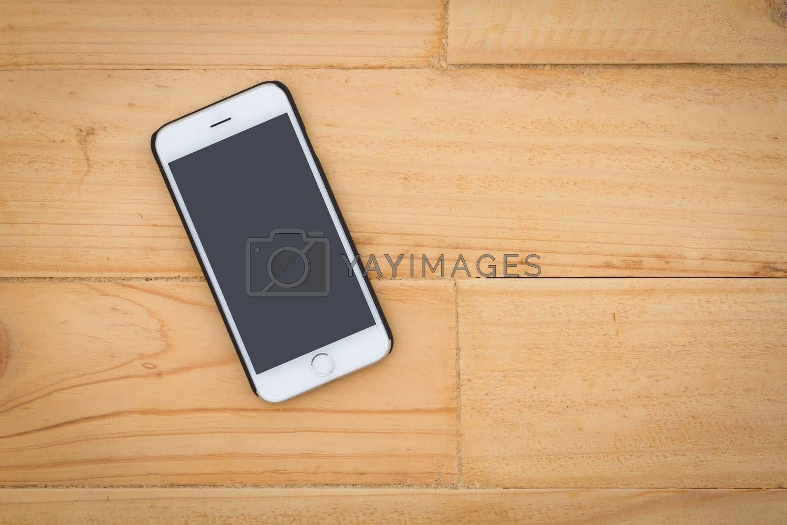 Smart phone on the table top of wooden background