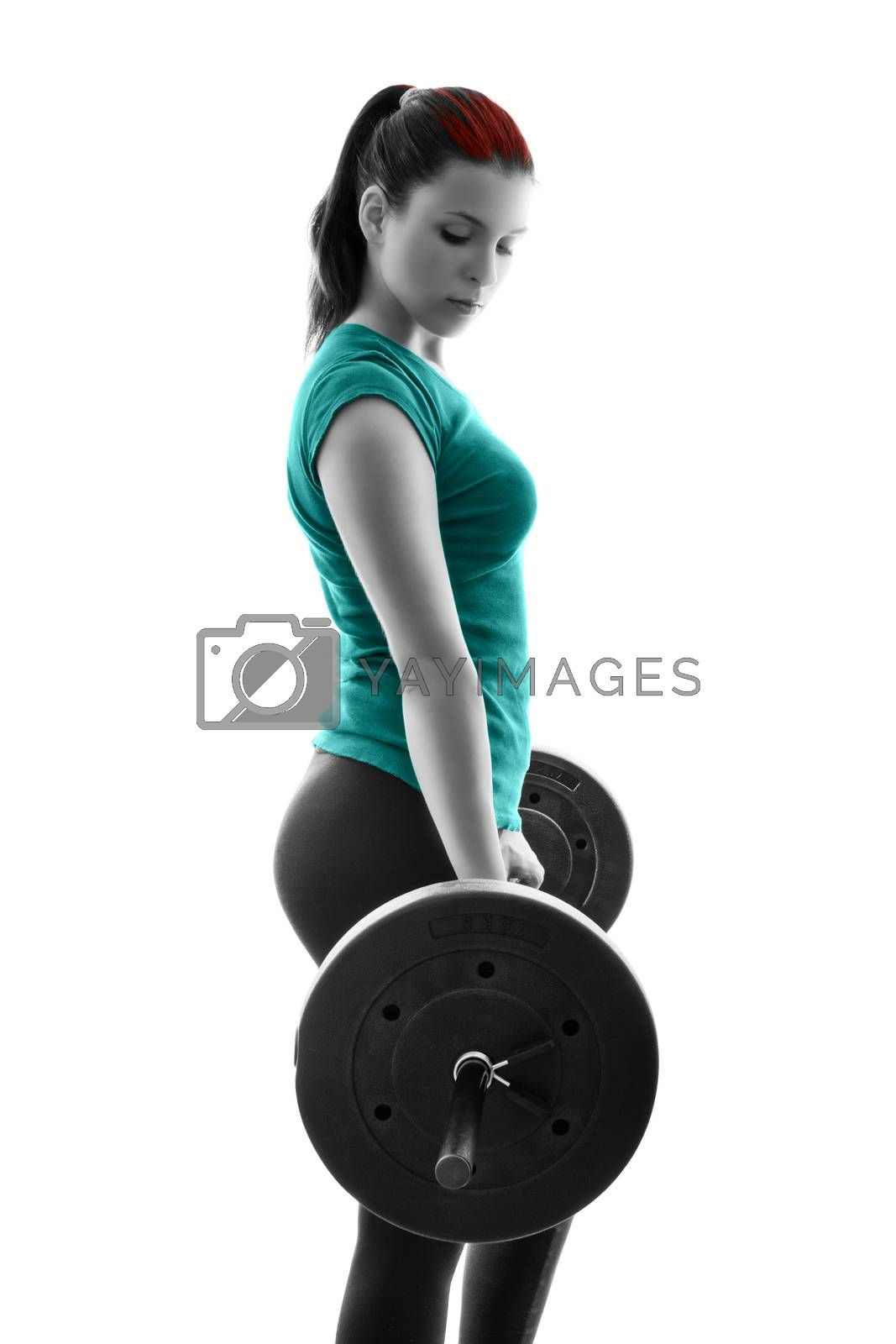 Fit attractive young woman working out with a barbell, backlit silhouette studio shot isolated on white background. Fitness and healthy lifestyle concept.