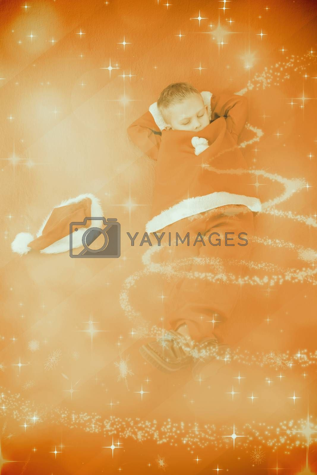 Little boy napping in santa costume against glittering christmas tree design