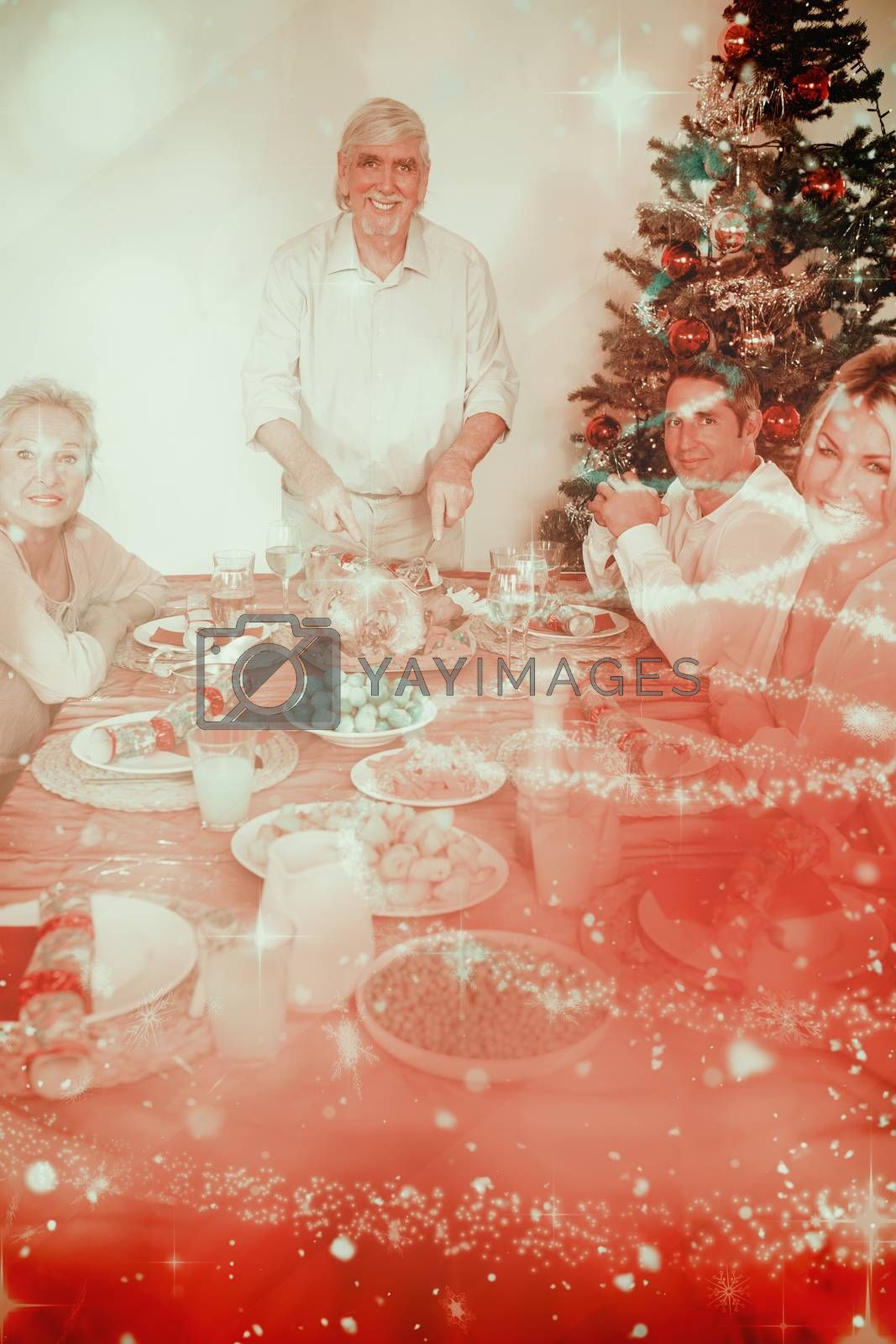 Composite image of happy grandfather carving the christmas turkey by Wavebreakmedia