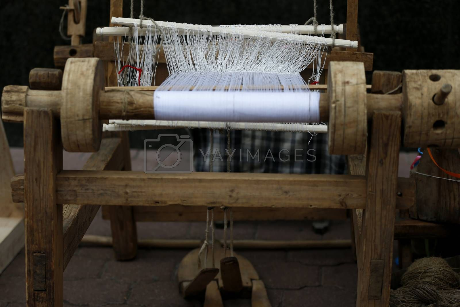 Ancient spinning machine.An ancient way to fabricate.Loom