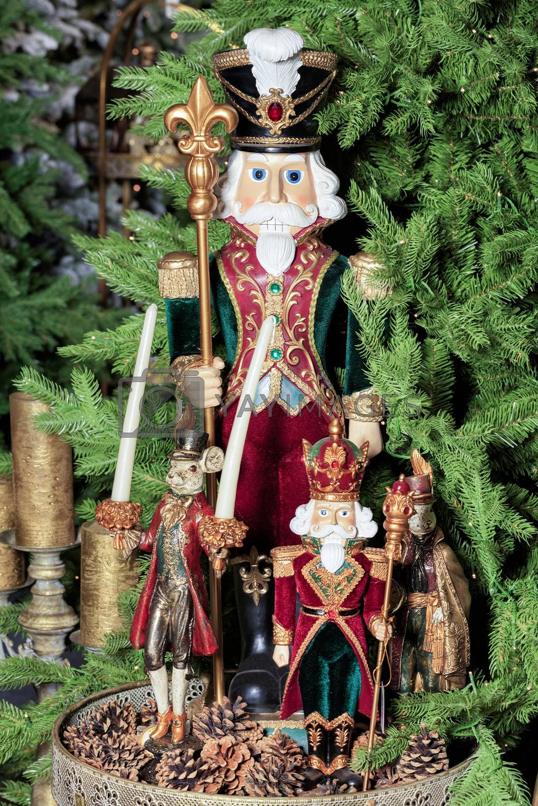 Royalty free image of Decorative Christmas toys from old tales on a background of green spruce branches and cones. by Sergii