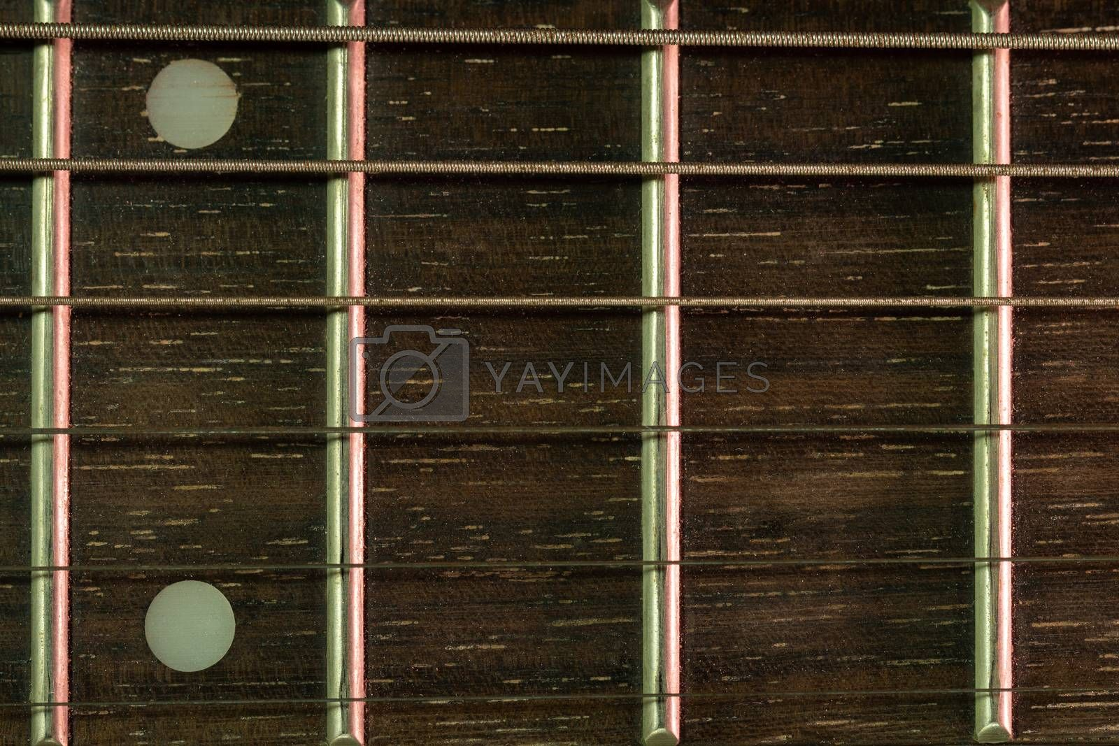 Closeup vintage guitar fretboard and the rust string is a part of the guitar. Concept of good memory About retro musical instruments and rock music.