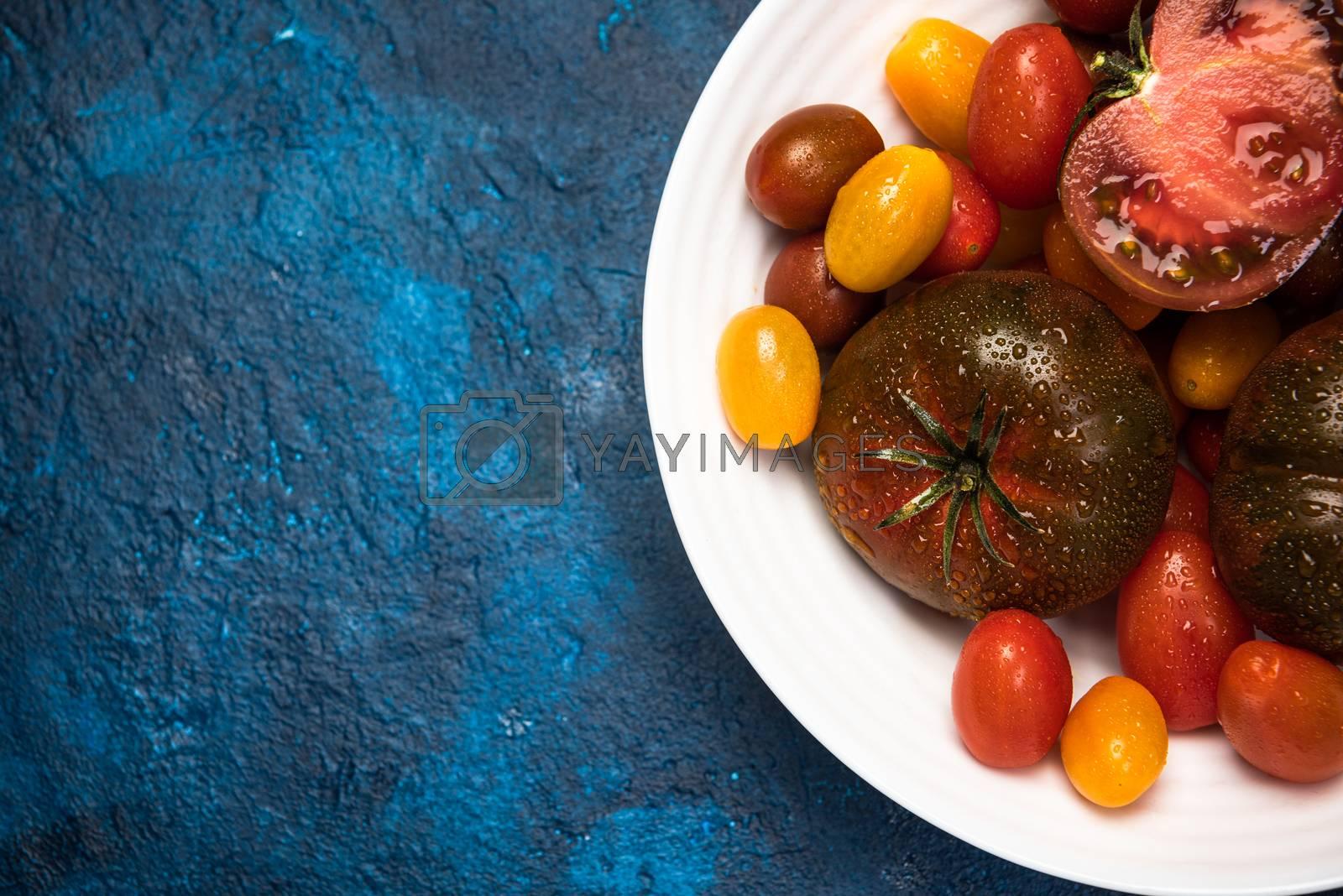 Vibrant Organic Tomatoes on Plate. Market Fresh Vegan Food. Plant Food Diet.