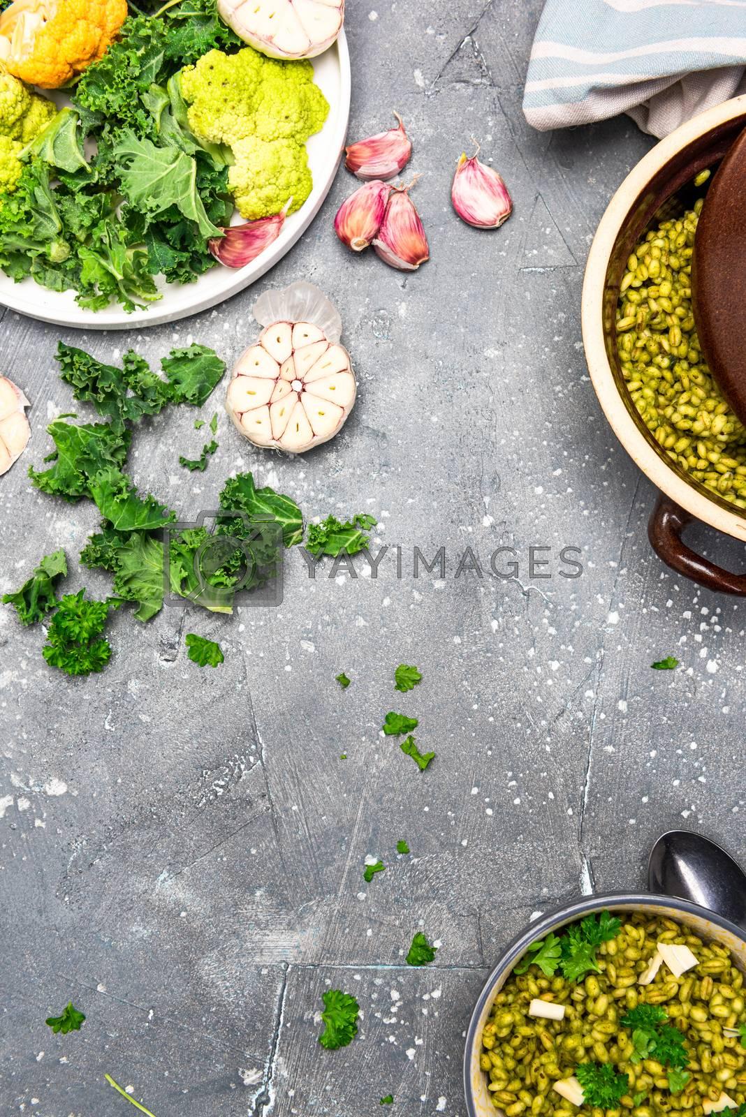 Healthy Eating. Vegetarian Brunch. Green Kale, Garlic and Groats in Bowl.
