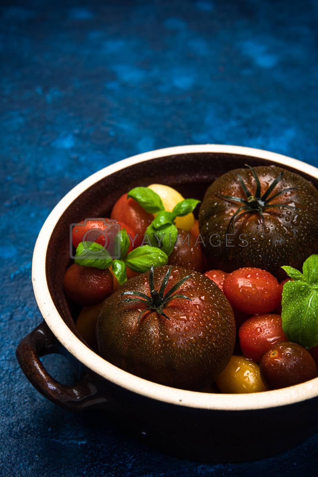Market Fresh Organic Tomatoes on Concrete Kitchen Table Top.