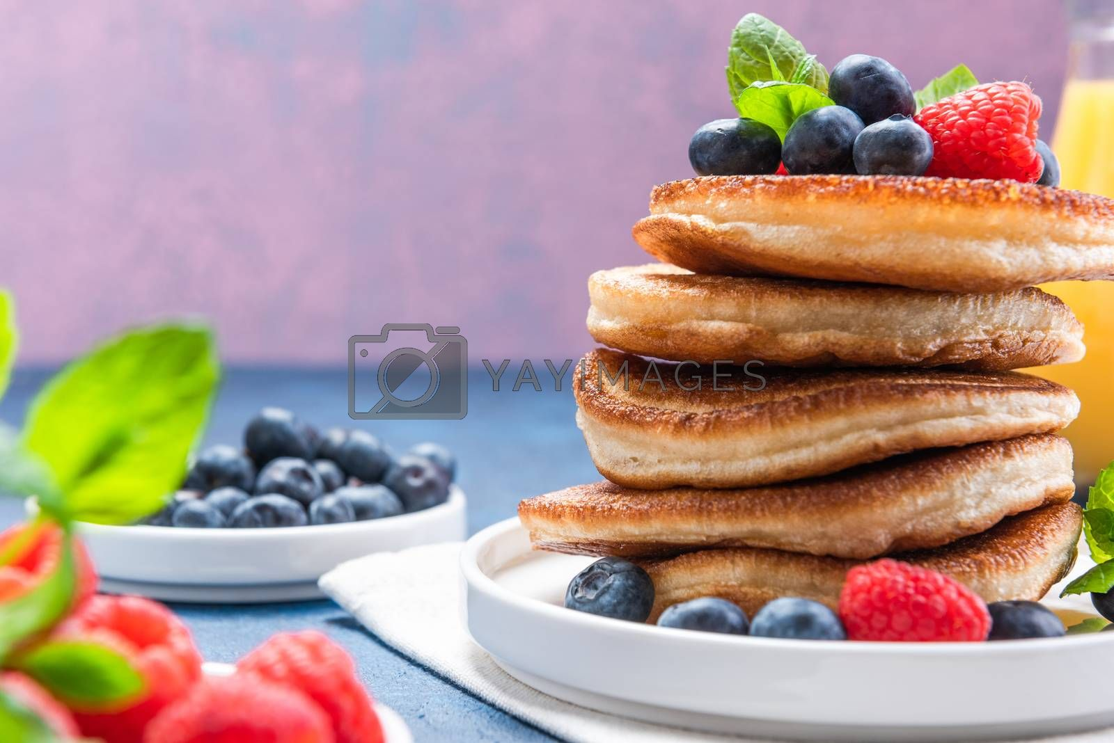 Pile of Pancakes Crepes Served with Fresh Fruits. Shrove Tuesday.