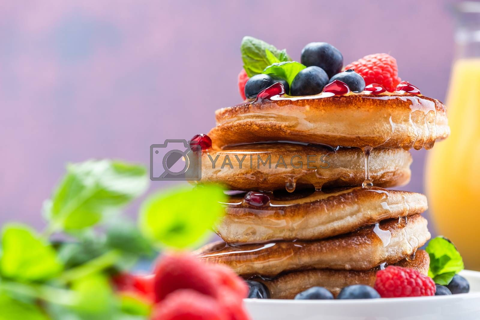 Pancakes with Maple Syrup and Fresh Fruits. Shrove Tuesday Brunch or Breakfast.