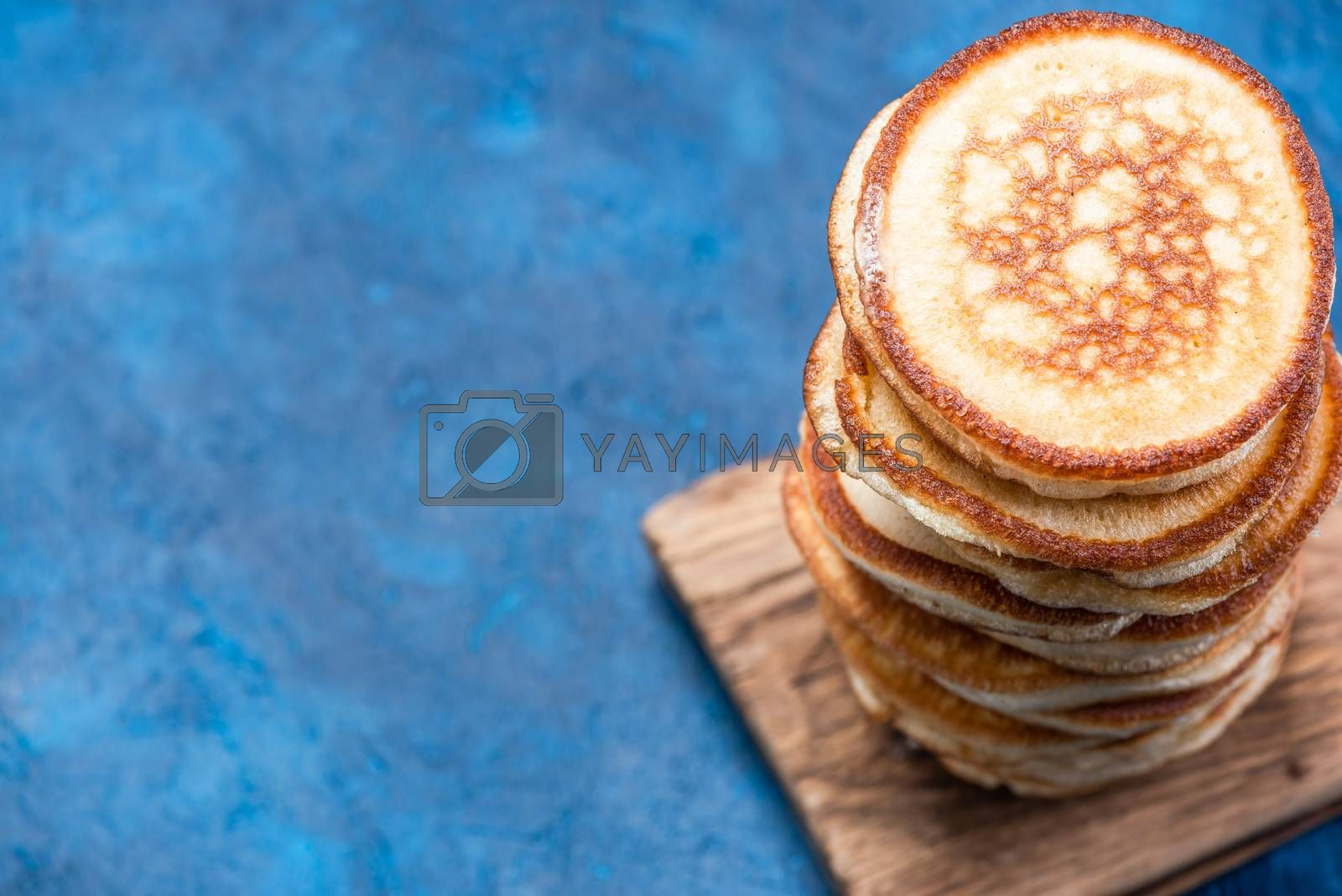 Stack of Pancakes on Wooden Board. Overhead View. Border Background.