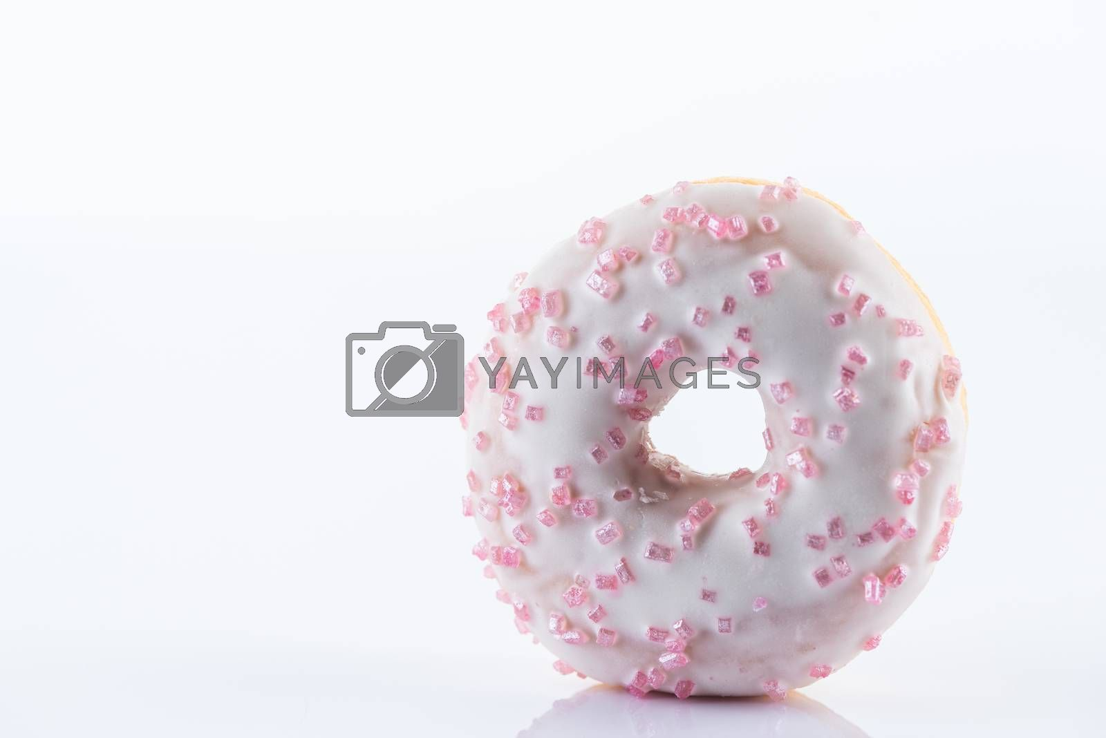 Single White Chocolate Donut or Doughnut. Studio Photo on White Background, Close Up view.