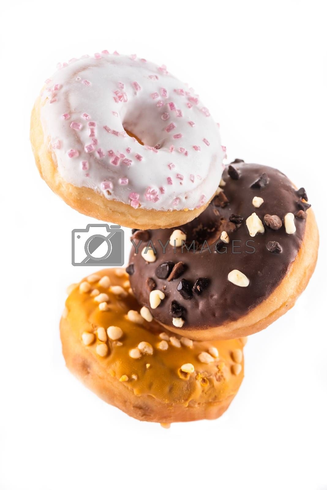 Flying Donut or Doughnut Creative Image. Falling Food On White Background. Food in Motion.