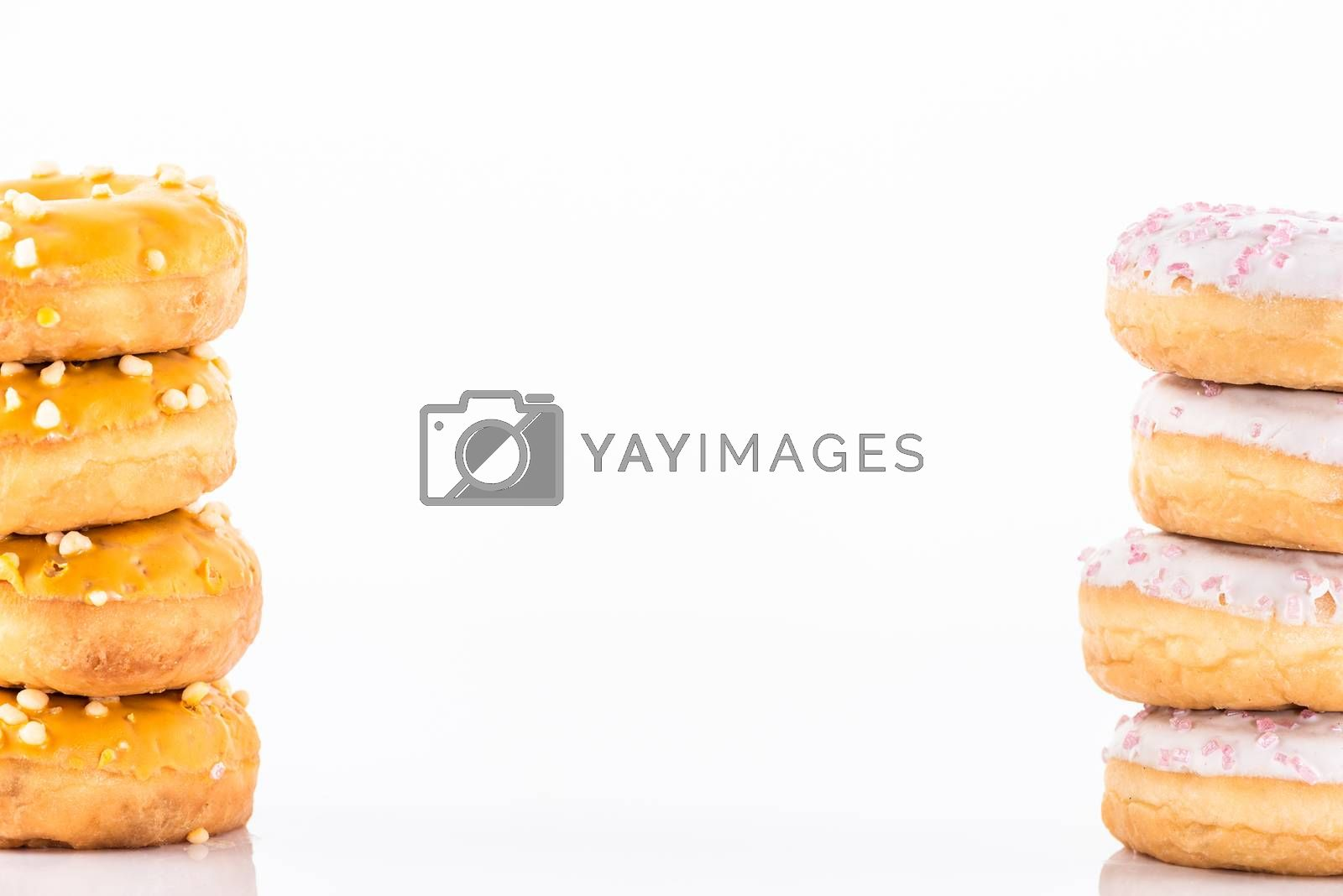 Donuts Tower Stack Pile on White Background. Food Border Background.