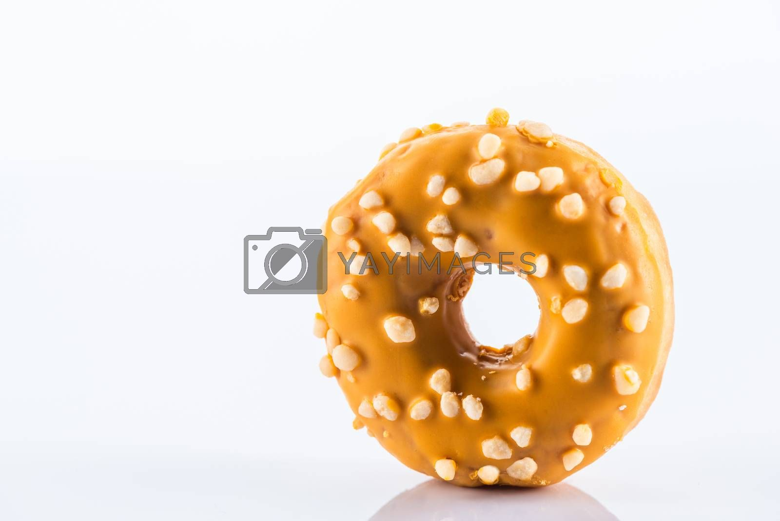 Single Salted Caramel Donut or Doughnut. Studio Photo on White Background, Close Up view.