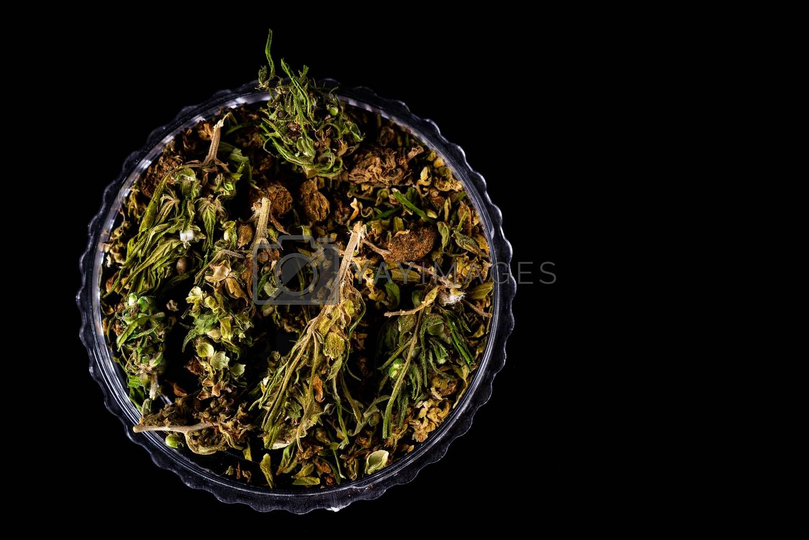 Cannabis Flower Buds in Glass Jar, Top Down Close Up. Dark Background. Medical Marijuana Concept.