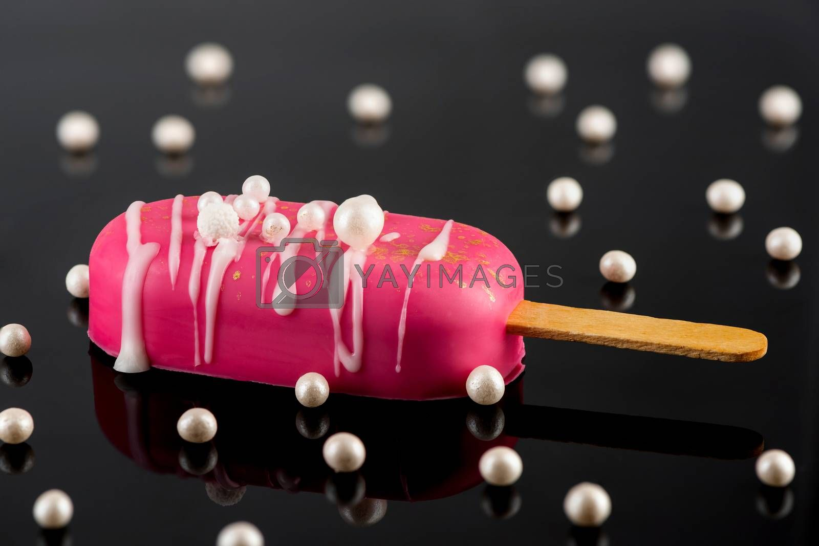 Pink Chocolate Popsicle on Dark Reflective Background. Creative Party Food.