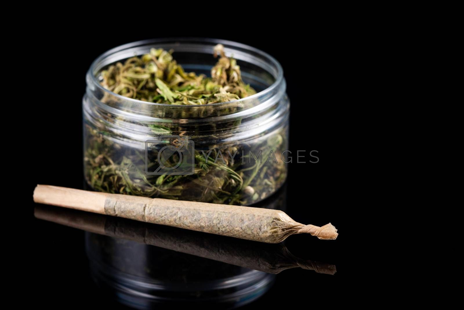Recreational Prescription Medical Marijuana Joint and Cannabis Flower Buds in Jar.