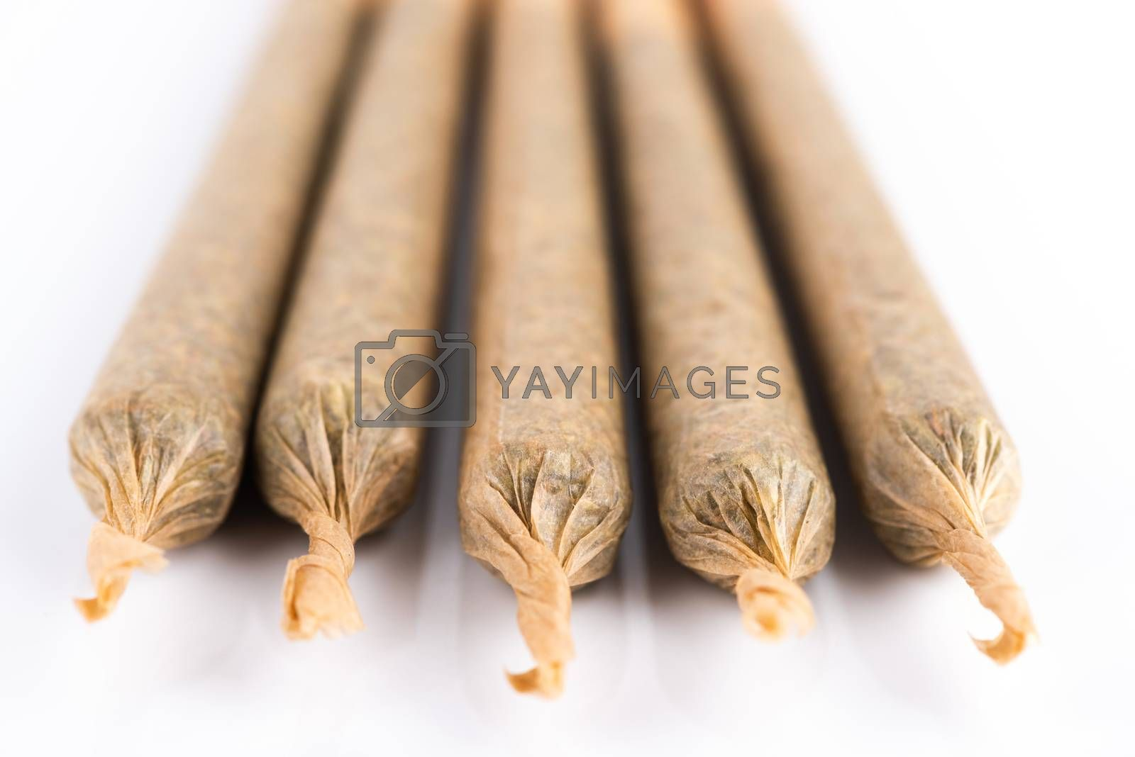 Medical Cannabis Marijuana Joints on White Background, Close Up View.