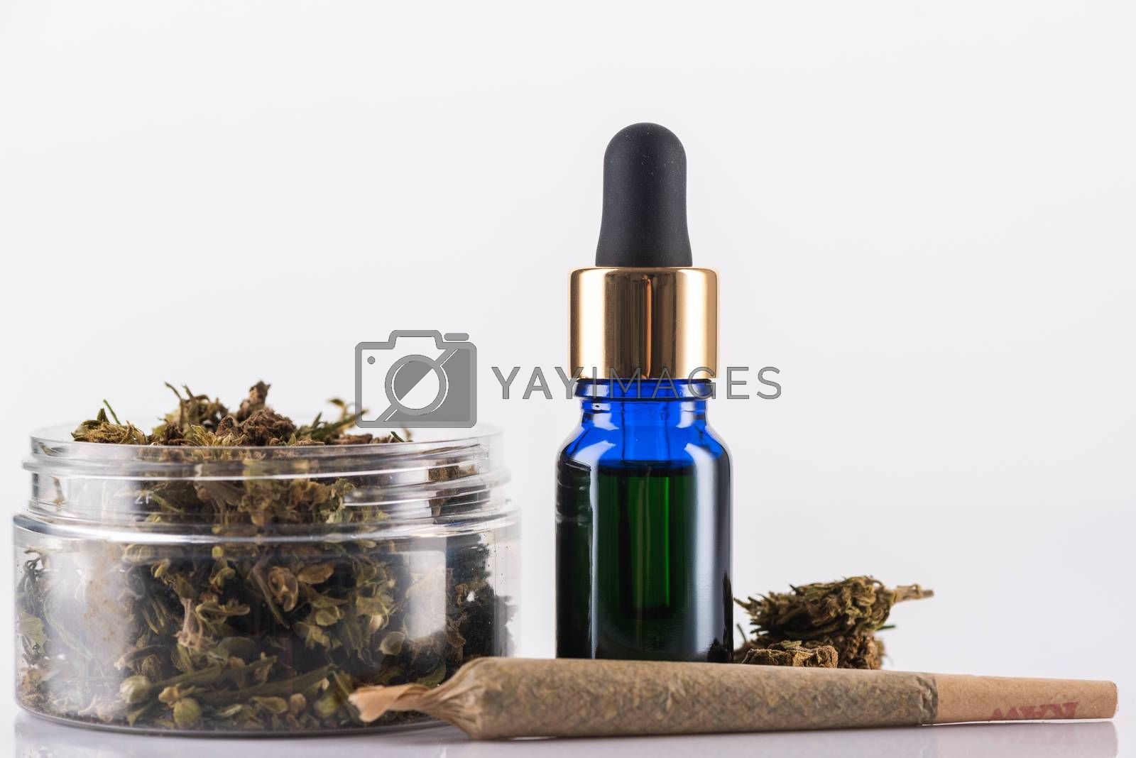 Cannabidiol Oil and Cannabis Flower Buds. Medical Marijuana Conceptual Image.