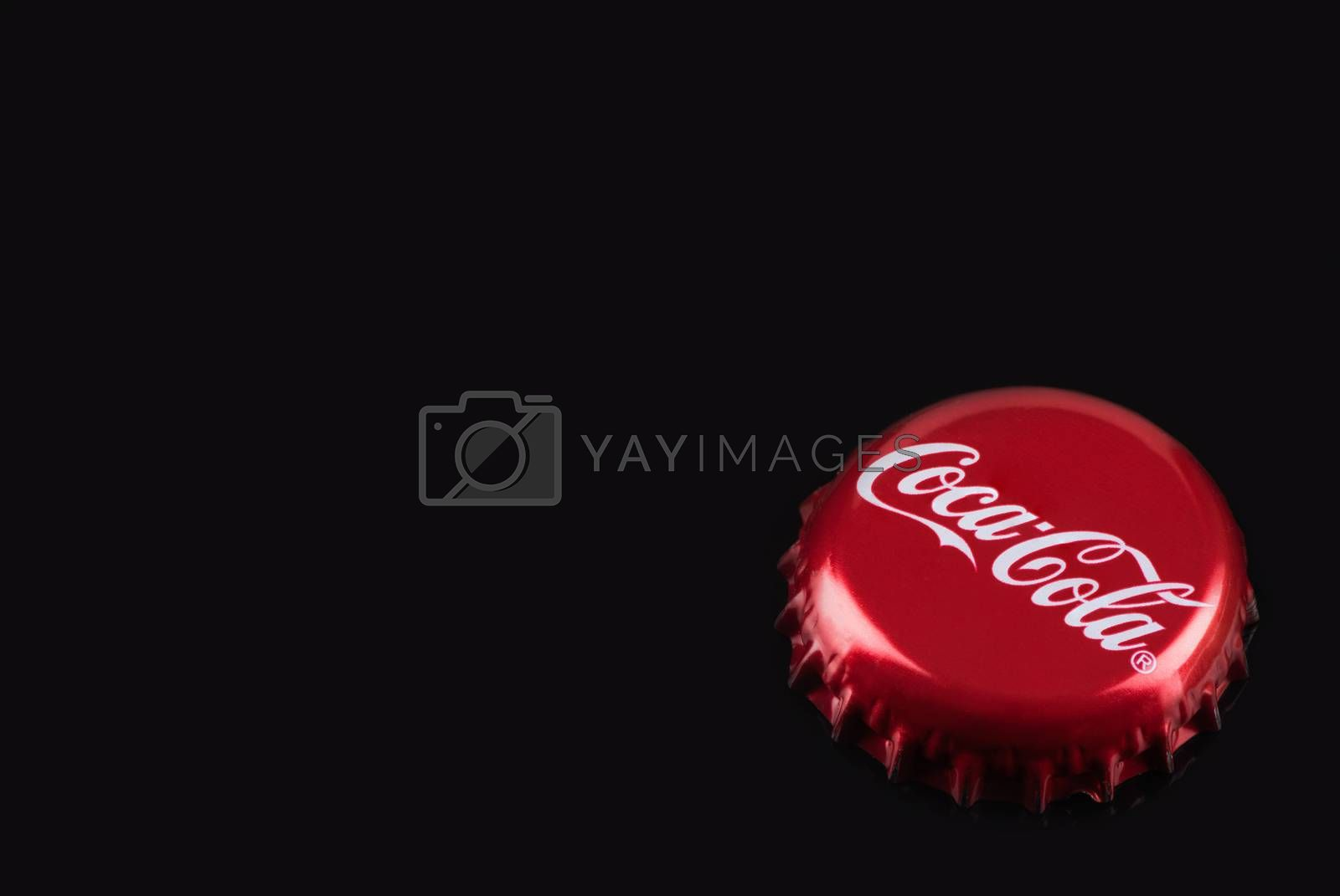 TARNOW, POLAND - FEBRUARY 01, 2020: Classic Red Coca-Cola Bottle Cap. Cocal-Cola is One of the Most Popular Refreshing Drinks.