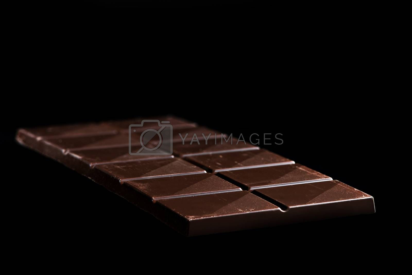 Chocolate Whole Bar on Black Background. Closeup View by merc67