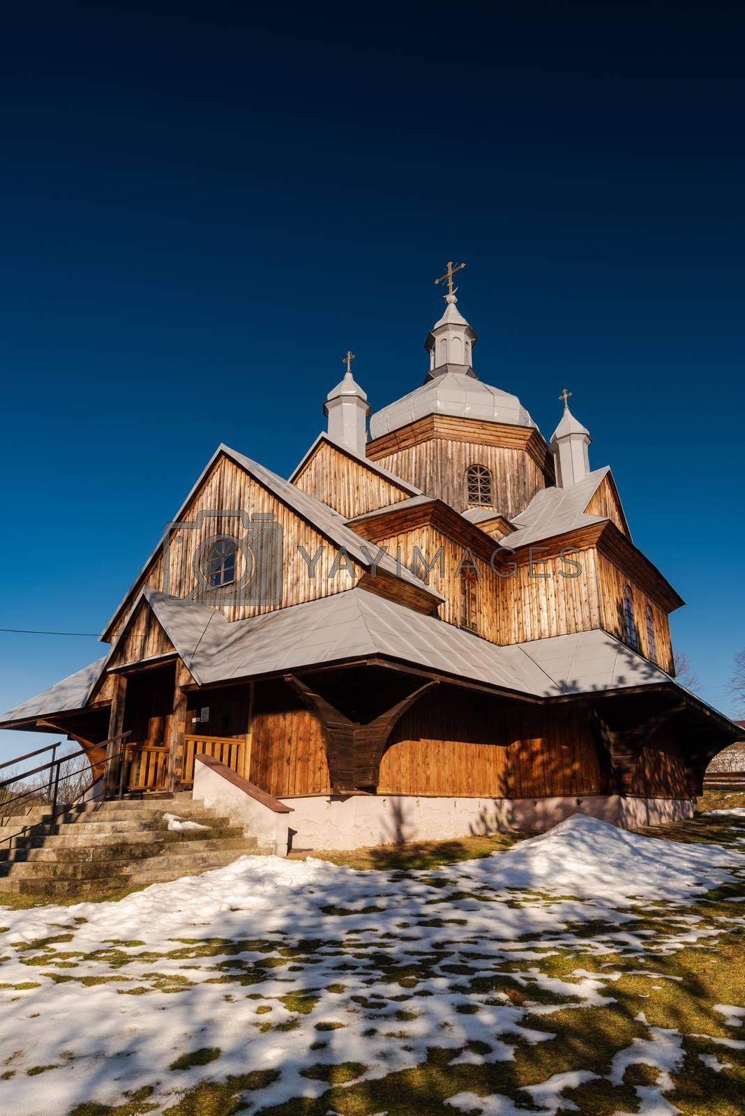 Wooden Orthodox Church in Hoszow. Carpathian Mountains and Bieszczady Architecture in Winter.