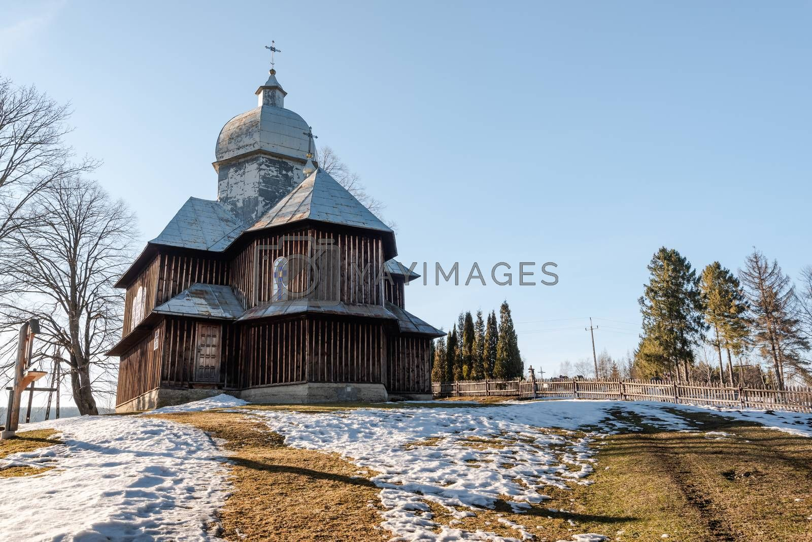 Exterior of Hoszowczyk Wooden Orthodox Church.  Bieszczady Architecture in Winter. Carpathia Region in Poland.