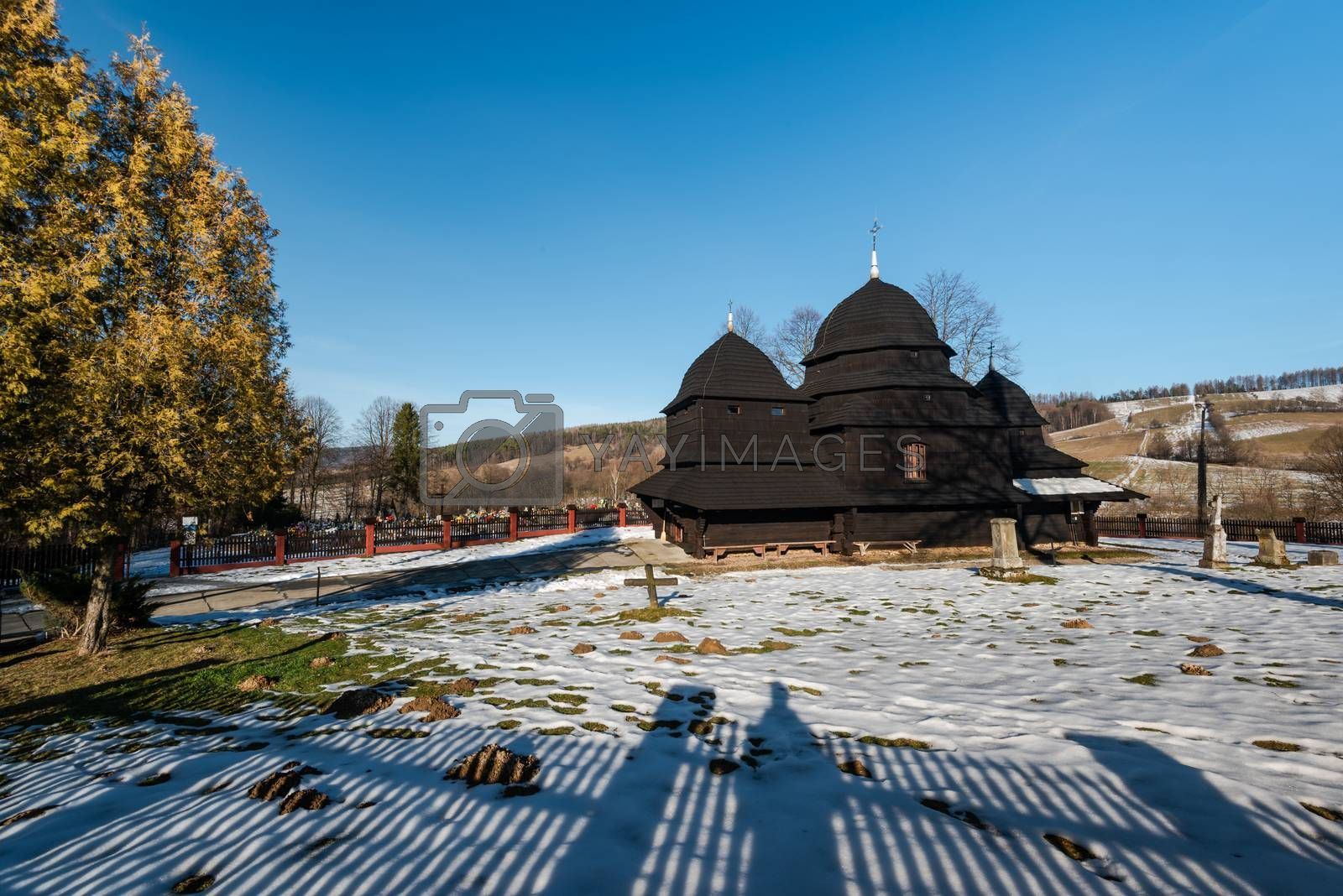 Exterior of Rownia Wooden Orthodox Church.  Bieszczady Architecture in Winter. Carpathia Region in Poland.