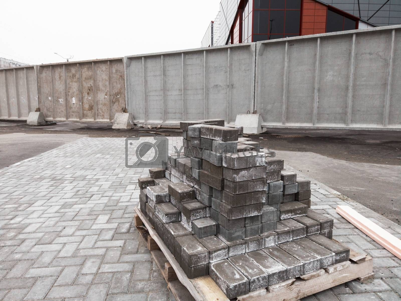 Stack of pavement stones at the road. Concept of repair of the sidewalk.