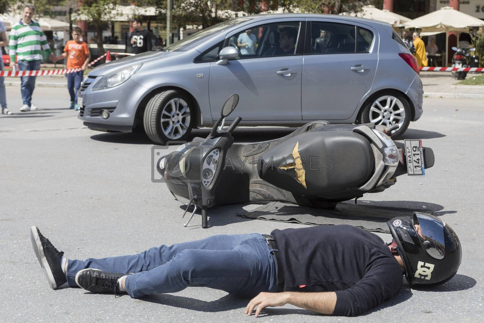 Thessaloniki , Greece - April 9, 2017: First aid, victim liberation in an car accident and helmet removal demonstration by the Hellenic Red Cross rescue team