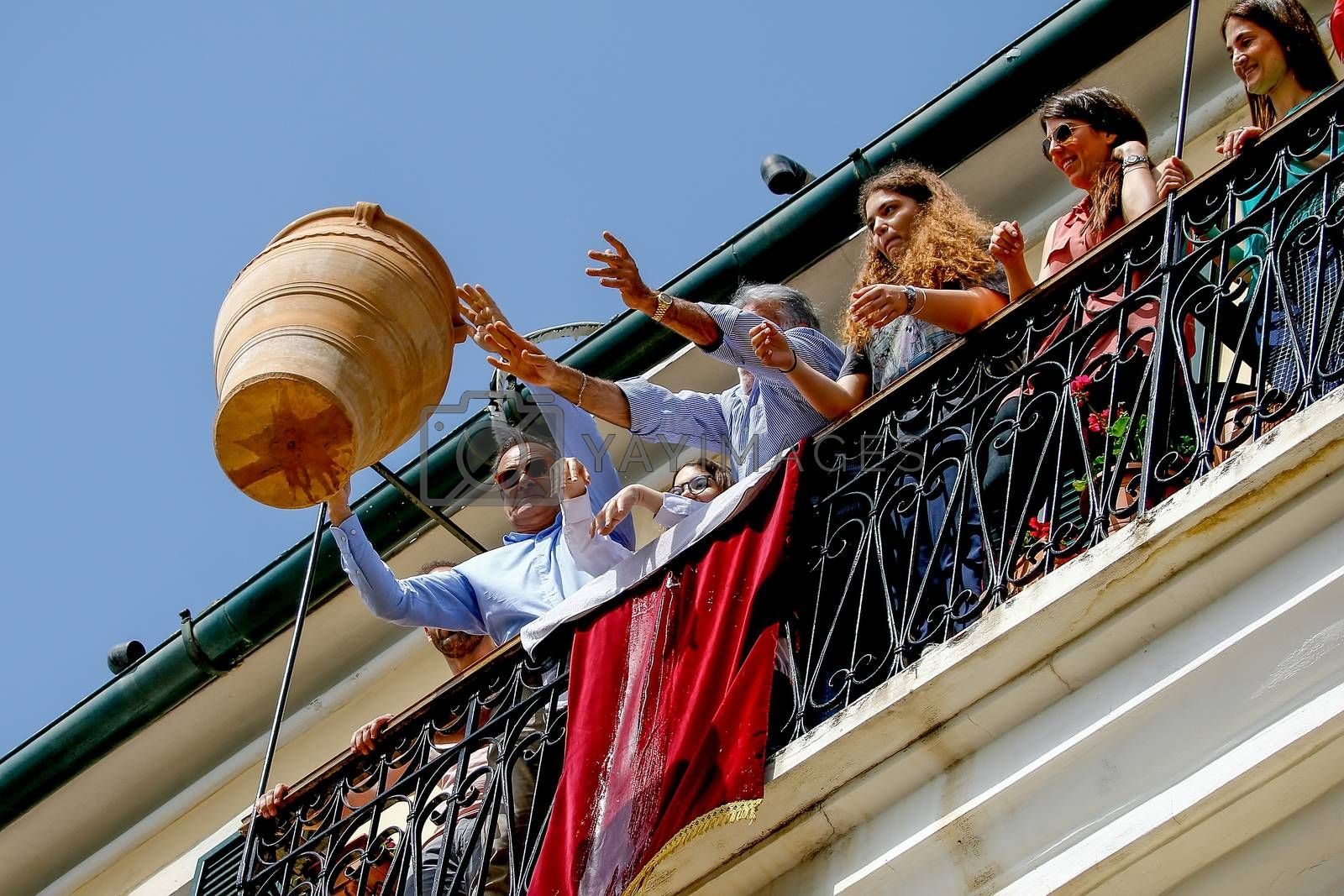 Corfu, Greece - April 27, 2019: Corfians throw clay pots from windows and balconies on Holy Saturday to celebrate the Resurrection of Christ