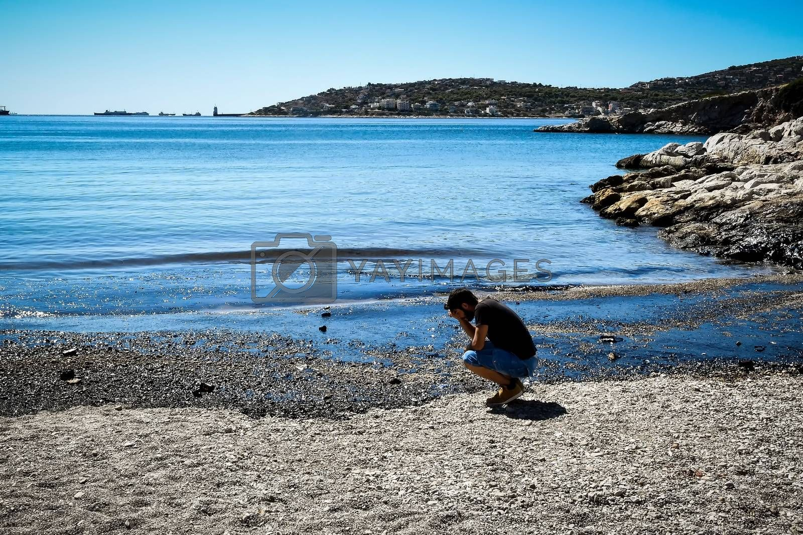 Salamina, Athens, Greece - Sept 13, 2017:Oil, leaked from a sinked ship, come ashore in Salamina Island near Athens, after an old tanker sank close to Salamis island