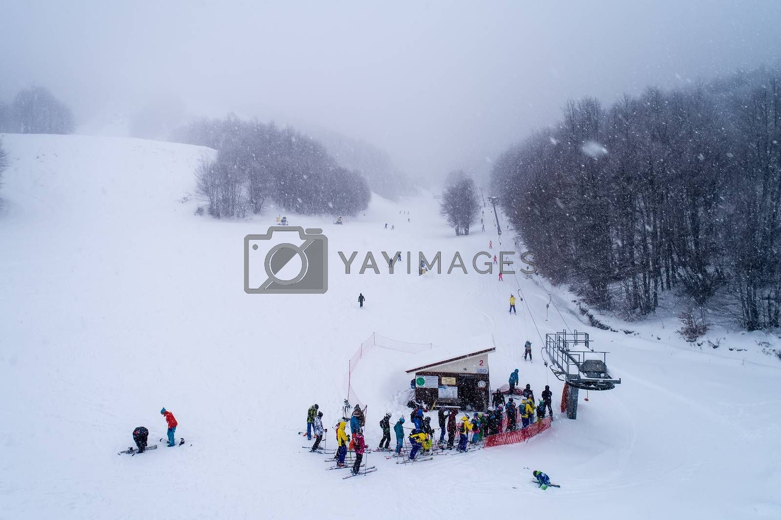 Naousa, Greece - January 13, 2018: Aerial View of skiers at Ski Resort 3-5 pigadia during the snowfall in the mountain Vermio.It is a modern ski resort with ski slopes with every degree of difficulty