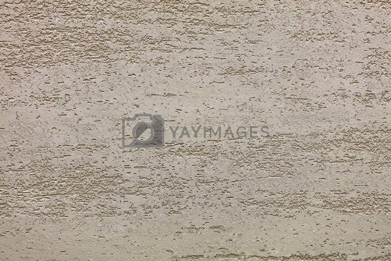Beautiful pattern texture of beige loose plaster on the wall
