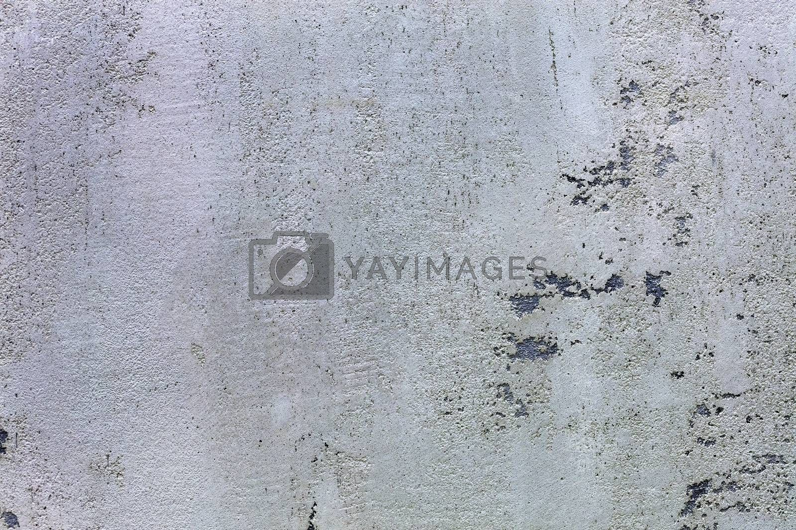 Beautiful texture of the pattern of grind gray concrete with black impregnations on the wall