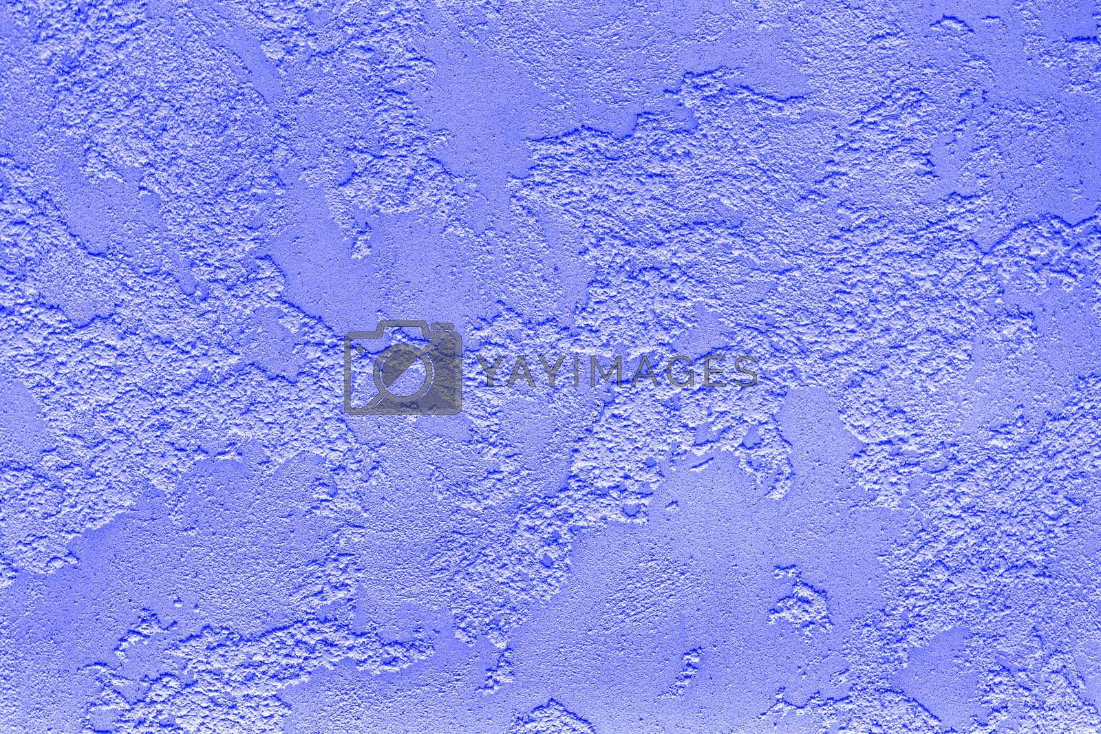Beautiful pattern texture of violet loose plaster on the wall