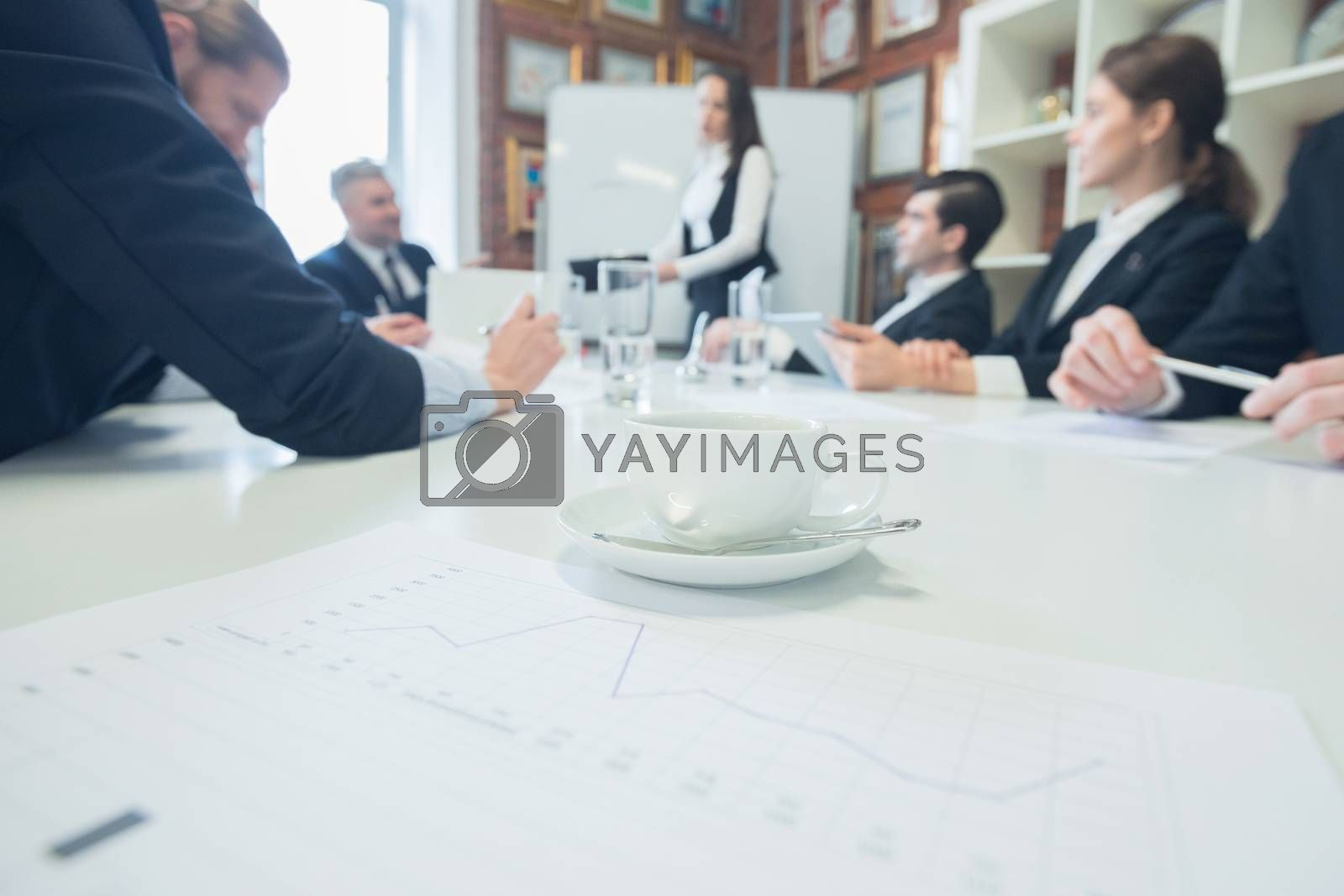 Mixed group in business meeting in office, finansial reports and analysis diagrams on table