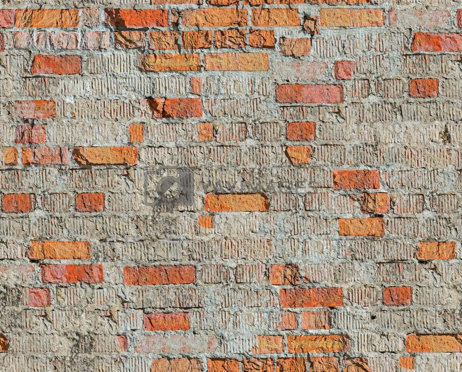 Brick wall of the old house of the 19th century restored after the bombing of the Second World War. Seamless texture