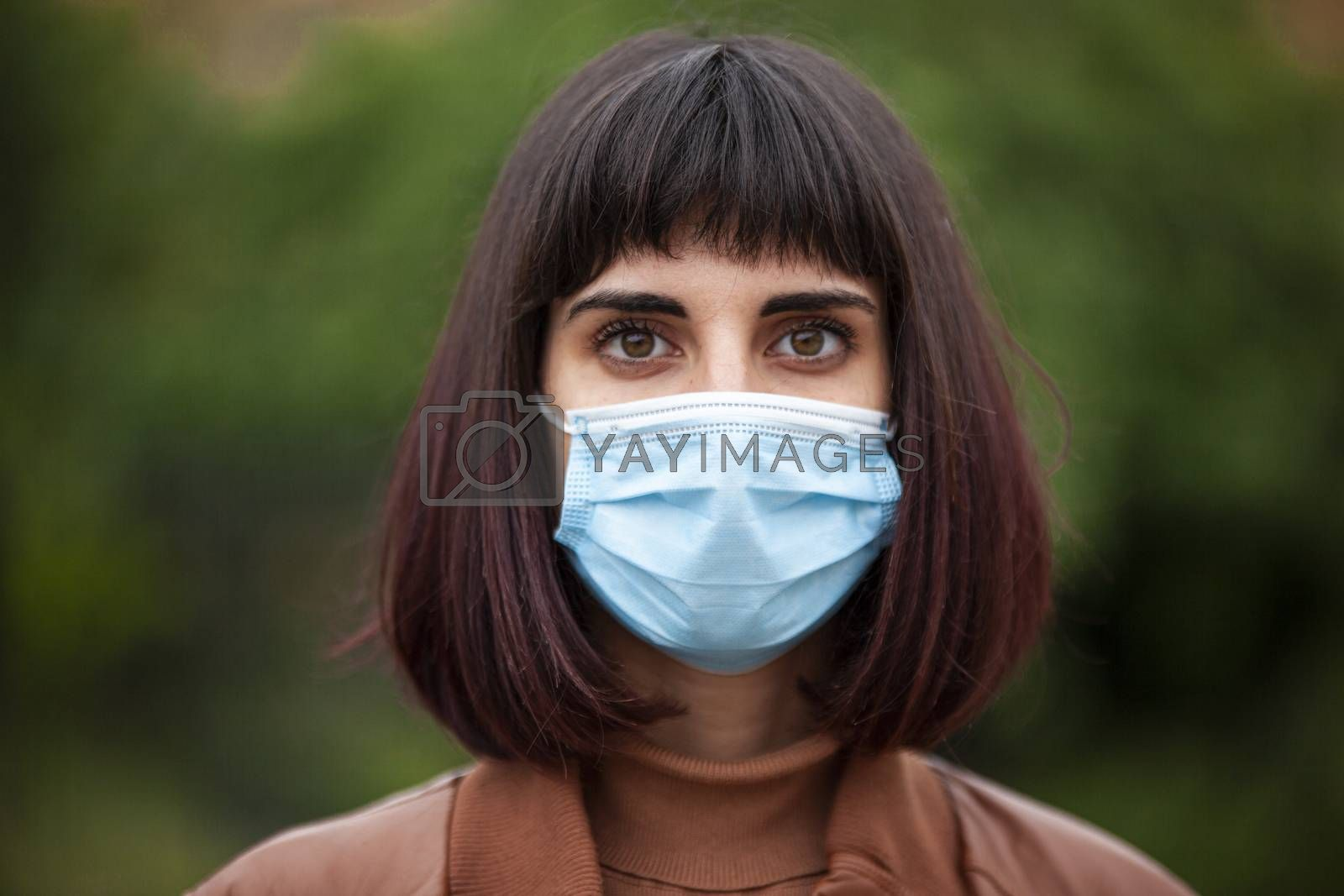 Close up Portrait of a Girl with medical mask outdoor during covid quarantine in Italy