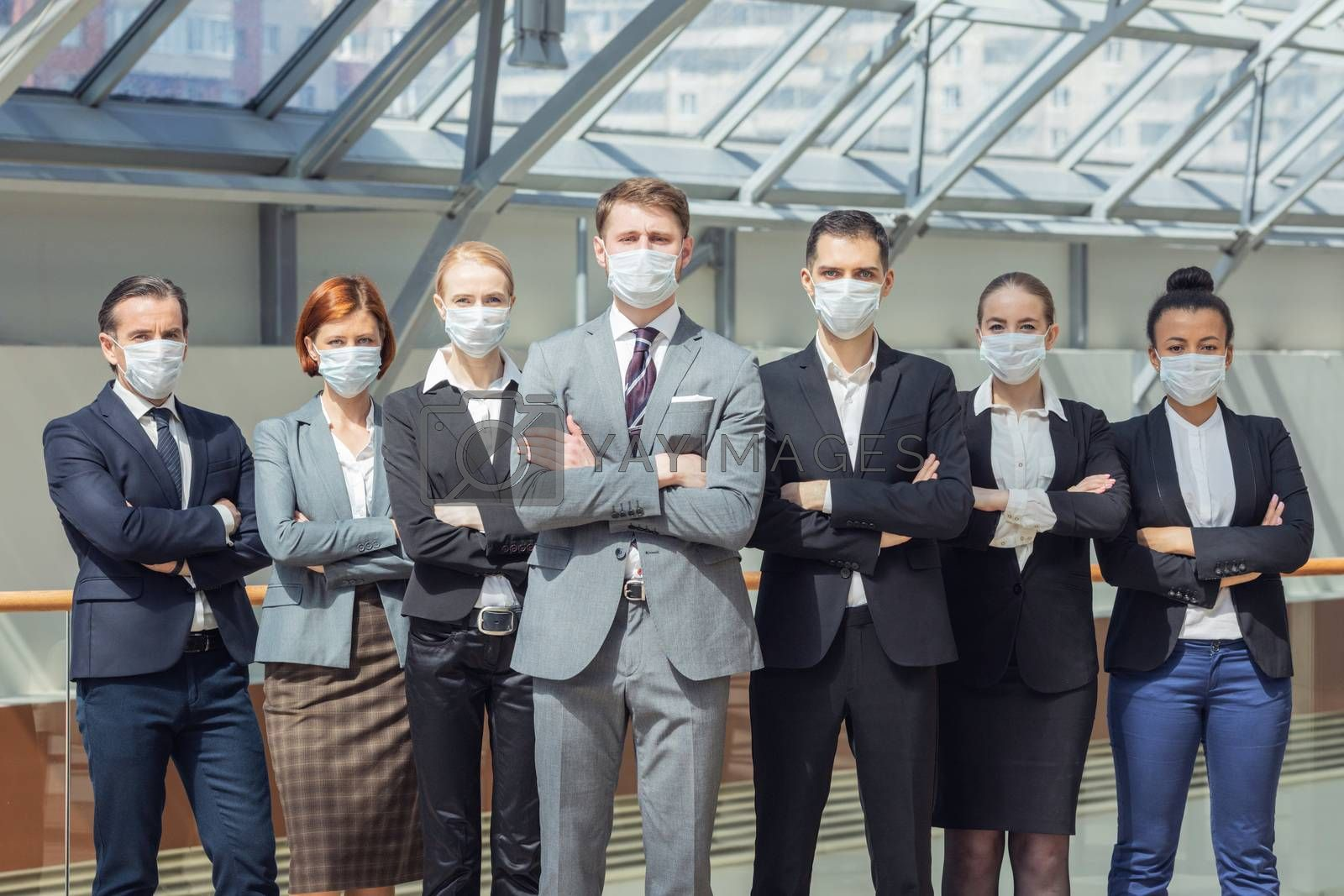 Business people wearing surgical masks and standing together, healthcare and covid-19 prevention concept