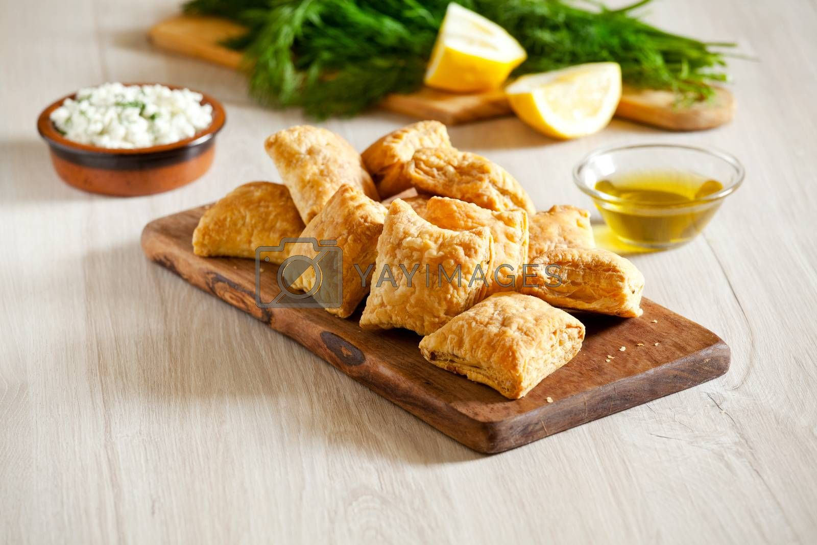 Platter of small homemade greek cheese pies with feta cheese