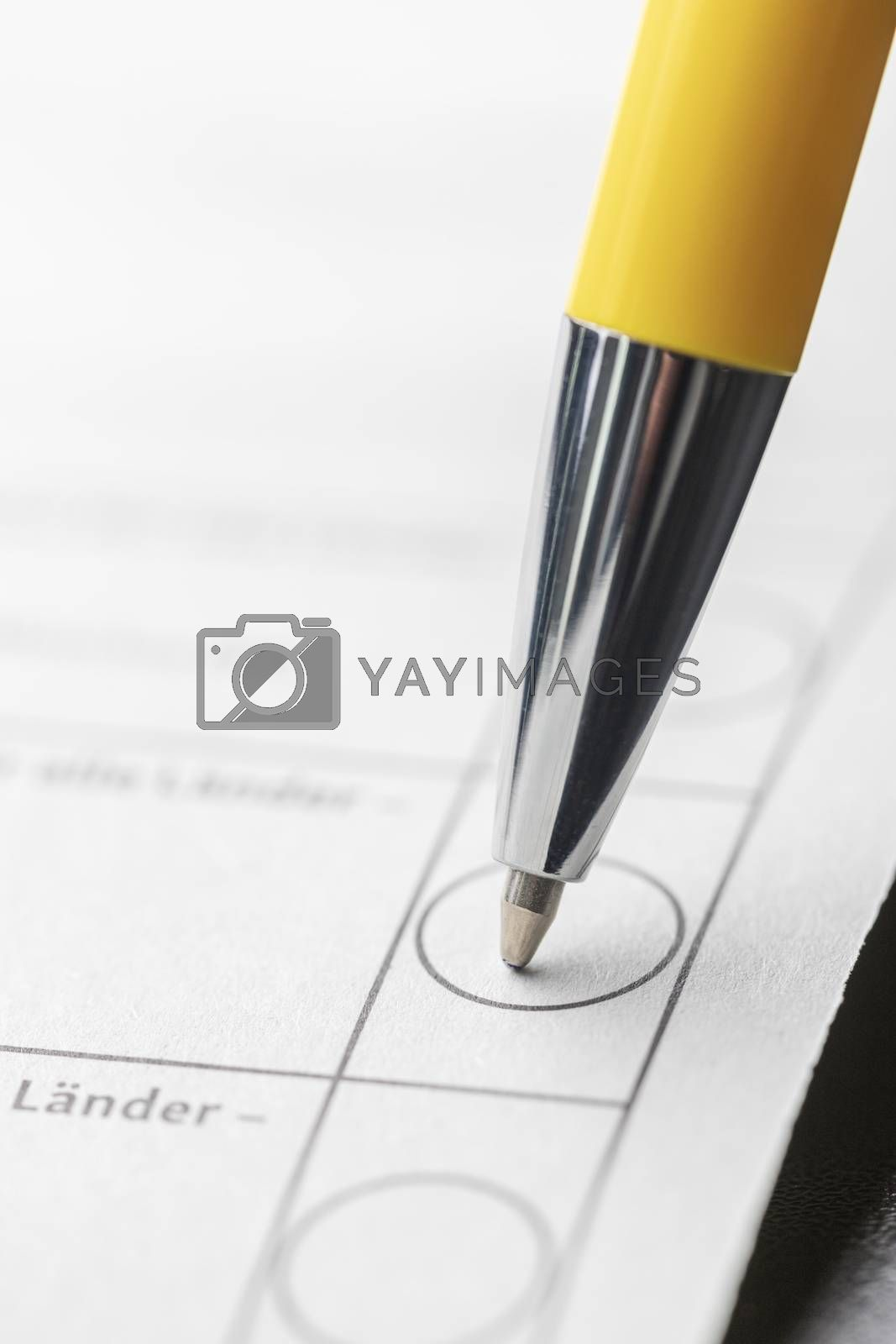 closeup of a pen on ballot paper