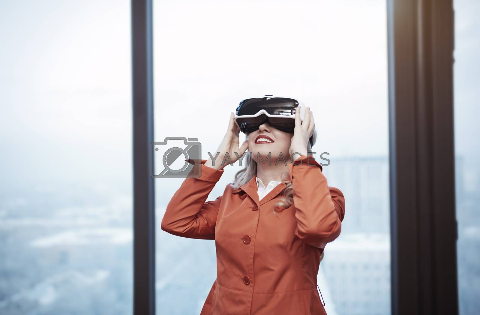 Woman at office wearing Virtual reality headset