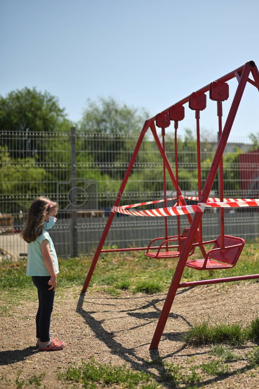 Girl and Children's Swings  Wrapped With Signal Tape by mady70