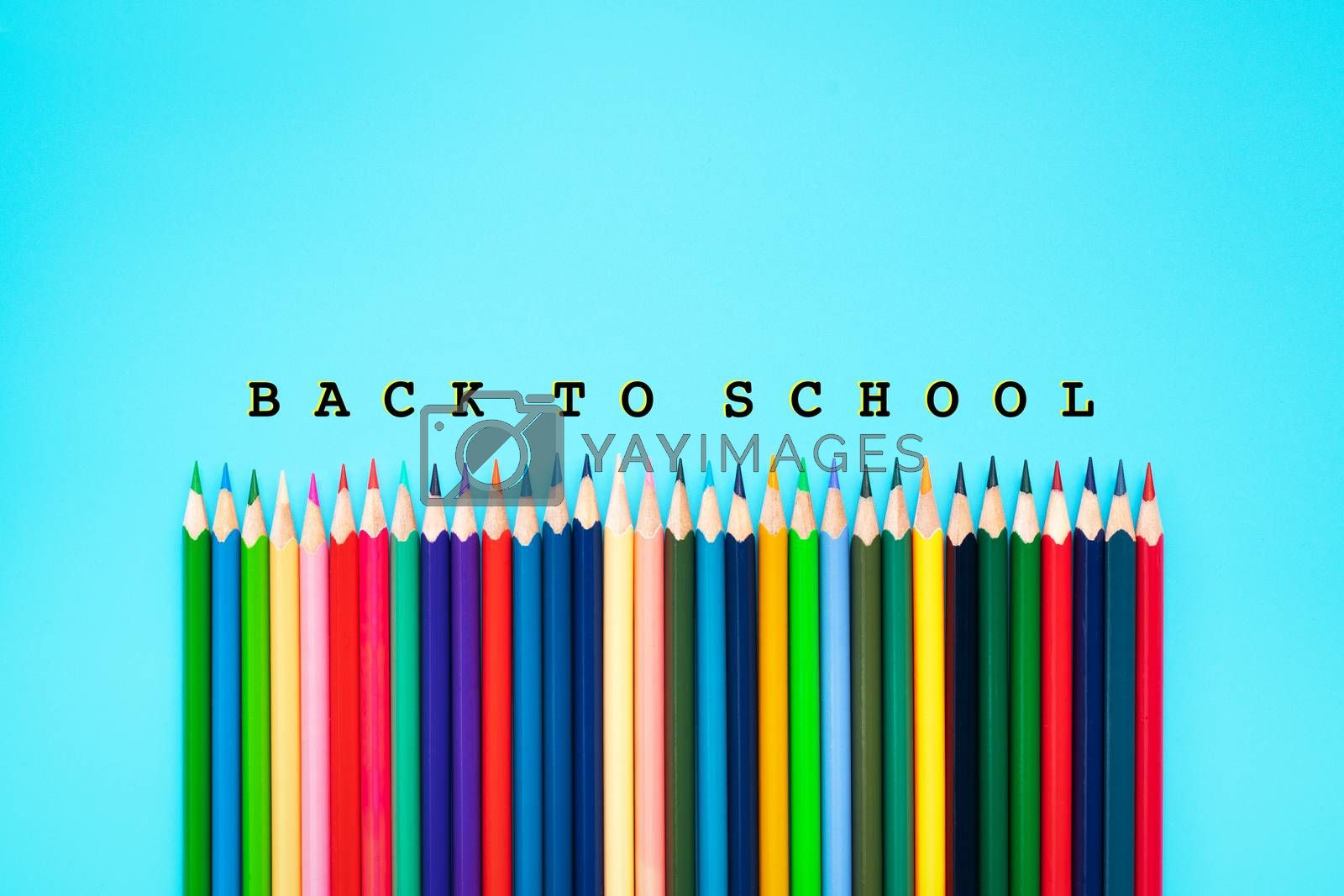 Welcome back to school background, colorful color pencil on blue backgrounds with copy space