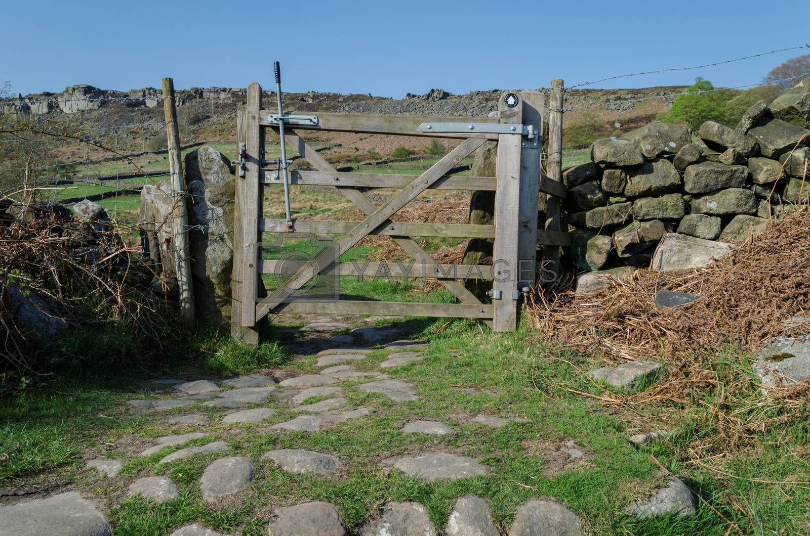 A small gate in a dry stone wall which allows ramblers to pass through.